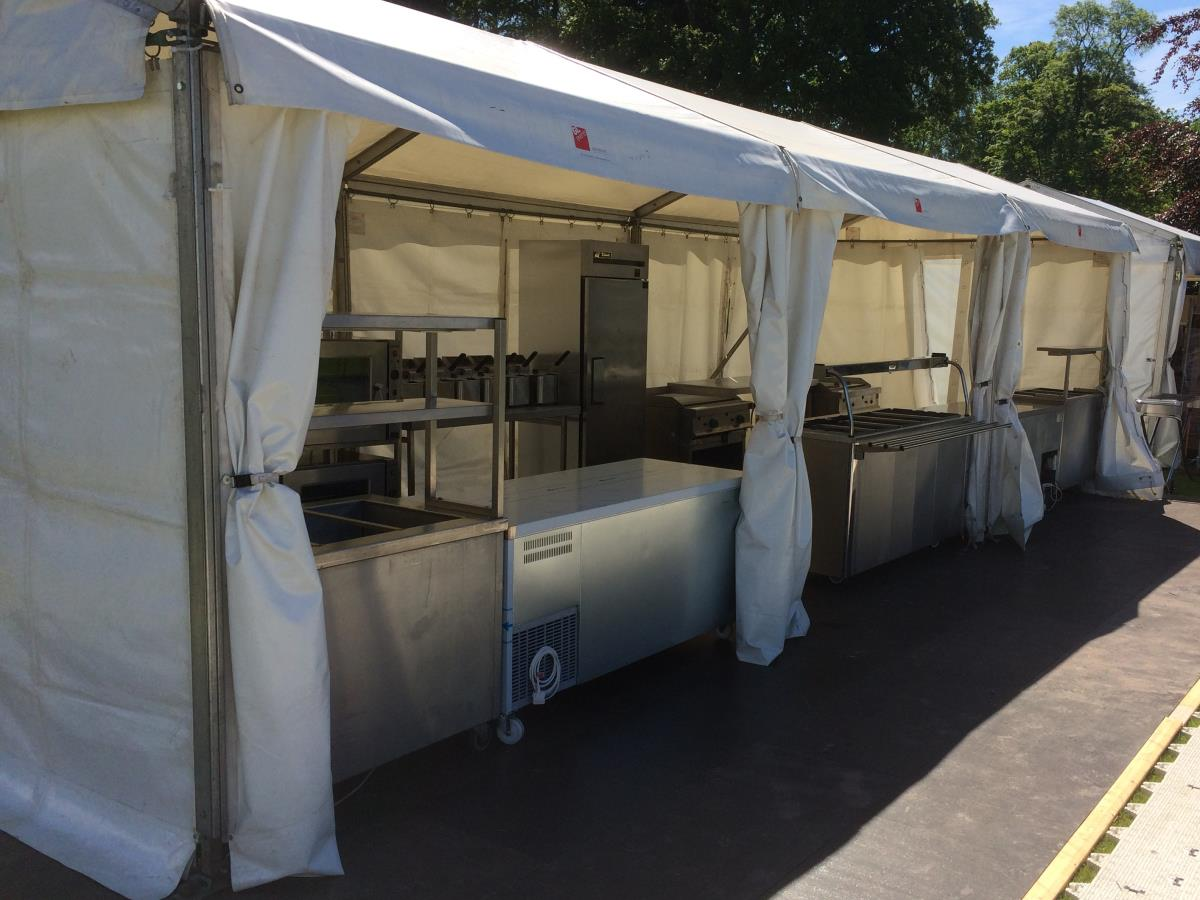 An open marquee kitchen to cater for spectators and competitors at the Great North Swim in the Lake District.